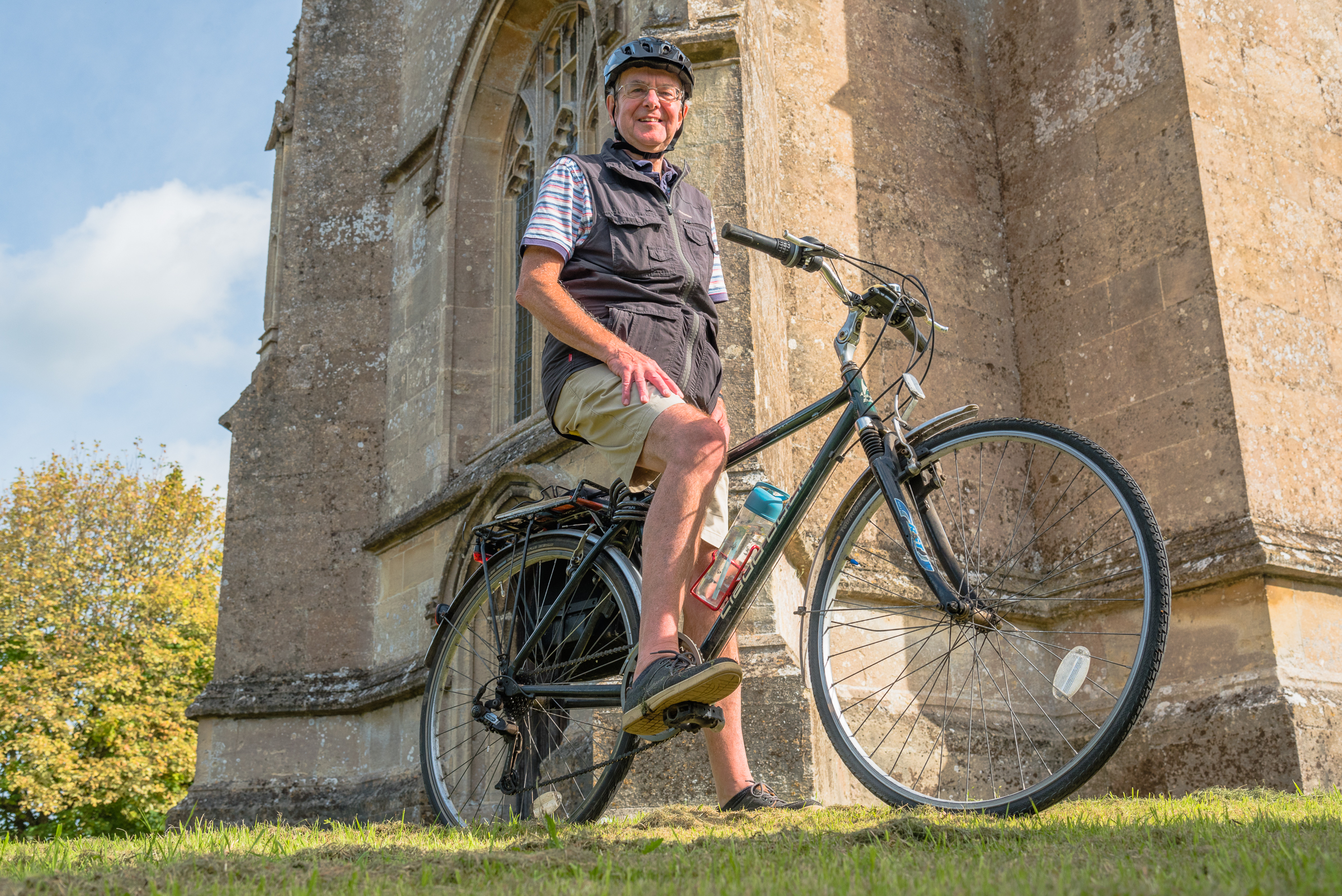 The Revd Chris Burdon with his bike at All Saints Church in Marden Gerry Lynch